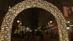 Low angle view of a lighten arch in Szent Istvan Square on Christmas in Budapest - stock footage
