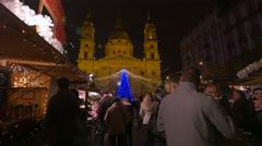 People walking and drinking in Szent Istvan Square on Christmas in Budapest Stock Footage