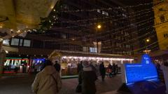 People walking towards stalls in Szent Istvan Sqare on Christmas, Budapest Stock Footage