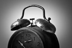 Horizontal black and white side view of an old alarm clock - stock photo