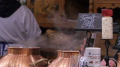 Steaming mulled wine at the Christmas market in Budapest Stock Footage