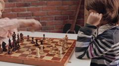 Children playing chess. Slider shoot Stock Footage