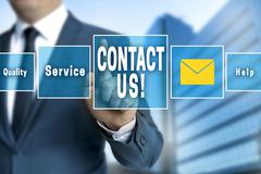 Contact us touchscreen is operated by businessman Stock Photos
