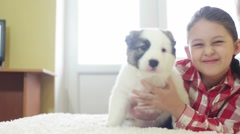 Child hugging a puppy Shepherd, slow motion Stock Footage