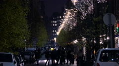 Walking and driving on a street with outdoor Christmas decorations in Budapest Stock Footage