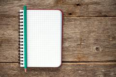 Stock Photo of Blank spiral notebook and pencil