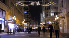 View of people walking on fashion Street on Christmas in Budapest Stock Footage