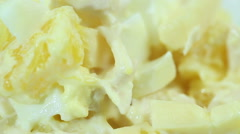 Salad of eggs, orange, chicken, cheese, standing Stock Footage