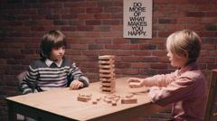 Children playing  Jenga. Stock Footage