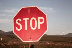 Stop Sign and Full Moon Stock Photos