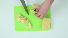 Slice the cheese into pieces Stock Footage