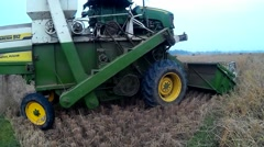 Paddy harvesting by machine Stock Footage