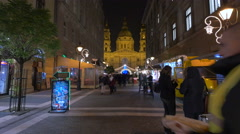 View of people walking and street stalls on Zrinyi street on Christmas, Budapest Stock Footage