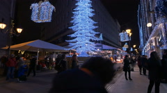 Low angle view of a lighten white Christmas tree on Fashion Street in Budapest - stock footage