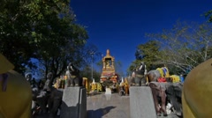 Dolly camera movement among elephant statues in a shrine in Phuket. Thailandia. Stock Footage