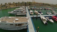 Aerial View of boats moored in harbor, Dubai, UAE Stock Footage