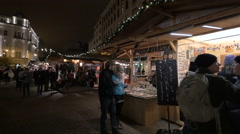 People looking at street stalls in Vorosmarty Square on Christmas in Budapest Stock Footage