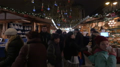 People walking near stalls with dishes, Vorosmarty Square on Christmas, Budapest Stock Footage