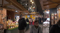 People walking by stalls with Christmas products in Vorosmarty Square, Budapest Stock Footage