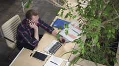 Bearded man gets the job over the phone, kneads his hands. Stock Footage