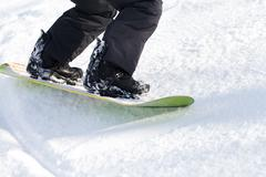 legs snowboarder, active sports - stock photo