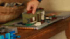 Focus on a boy building a house of legos Stock Footage