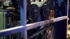 Sawmill. View on gears in working machine Stock Footage