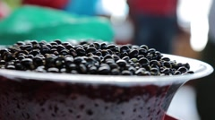 Tracking Shot in a Vegetabe Market to a Bowl full of Black Beans Stock Footage