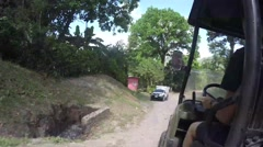 Time-lapse of ATV driving into a tropical mountain inn - stock footage