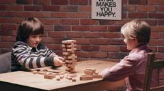 Children playing  Jenga. Slow motion Stock Footage