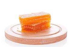 Honeycomb on a wooden board Stock Photos