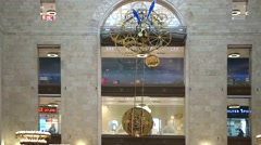 Enormous clock with a large pendulum in a Detsky mir shop Stock Footage