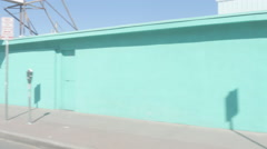 Driving by a Light Blue Wall in a Border Town Stock Footage