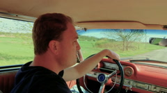 Man Driving Old Car On Country Road Stock Footage