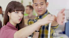 4K Team of fashion designers working together, talking & checking measurements.  - stock footage