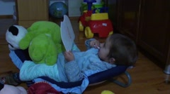 Toddler comfortable resting and drawing Stock Footage