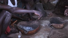 Hamer tribe men eat and talk inside traditional hut in Omo Valley Stock Footage