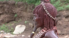 Hamer women with traditional shell juwelery on head close up in Omo Valley Stock Footage