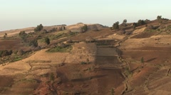 Traditional village rondavel huts in Simien Mountains in fields Stock Footage