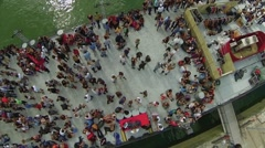 Aerial View of People at social gathering parting on deck of ship Stock Footage