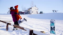 Young people hugging and posing in winter day - stock footage