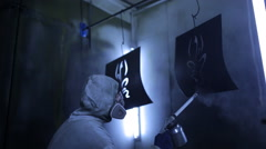 Painter in a protective suit and mask in a special room Stock Footage