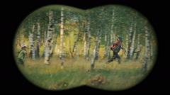 Children in forest - binoculars view 3 Stock Footage