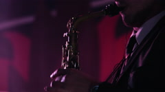 Close-up footage of caucasian man playing saxophone at nightclub Stock Footage