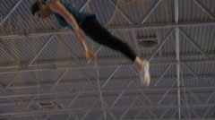 Gymnast jumping on the trampoline, slow motion Stock Footage