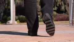 Black leather platform shoes go away Stock Footage