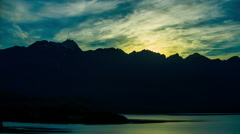 Time Lapse - Clouds float over Lake at Sunrise Stock Footage