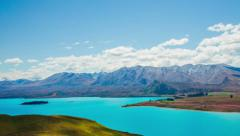 Time Lapse - Ariel View of Lake Tekapo with Mountain Range Stock Footage
