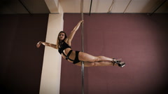 Slim pole dance woman flying on pole. Spots motion effect Stock Footage