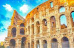 Defocused background of the Flavian Amphitheatre, aka Colosseum, Rome, Italy Stock Photos